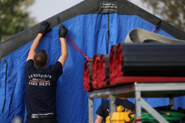 firefighter putting up work tent