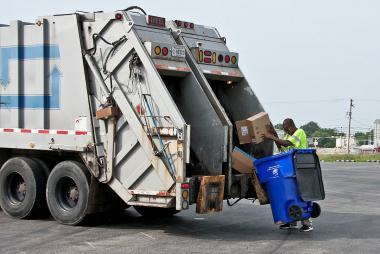 Image of recycling truck and can