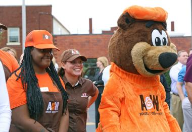 Image of A&W mascot and employees