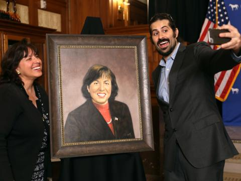 Mayor Isaac and her son Jacob take a selfie with her new portrait.