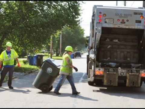 City crews service waste containers.