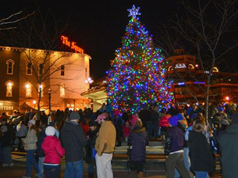 Christmas tree lights up Triangle Park at Luminate Lexington