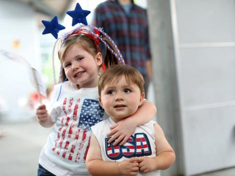 two kids wearing red, white and blue