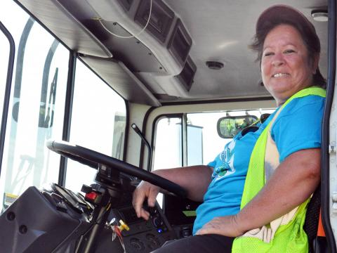 woman in driver's seat of work truck