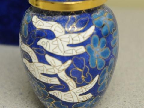 Officers booked an urn into Property and Evidence.
