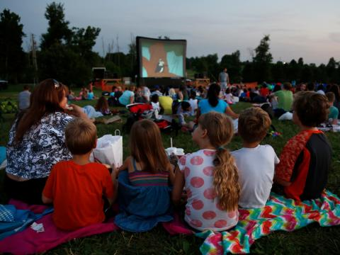 Patrons enjoy a movie in Jacobson Park at Friday Flicks.