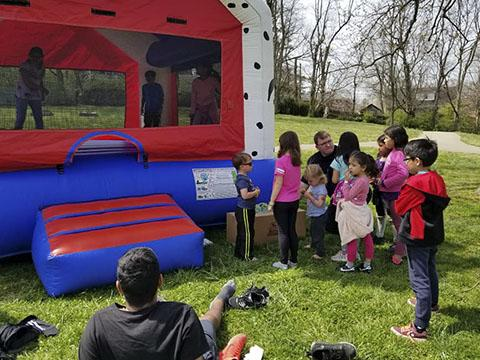 a group of kids waiting to enter a bounce house