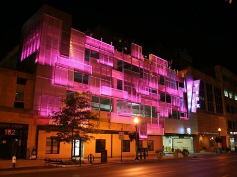 Image of Helix Parking Garage at night with pink lights