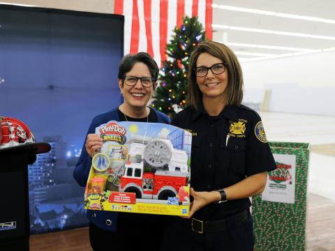 Image of Mayor Gorton and Chief Chilton holding a toy