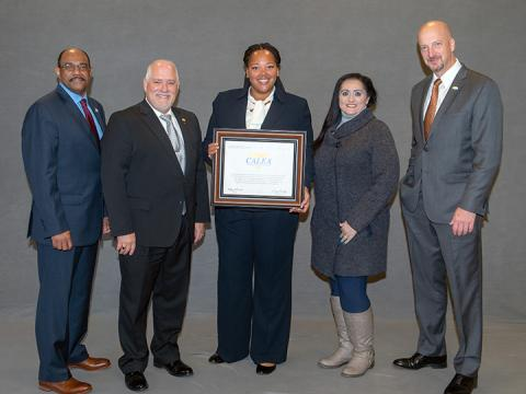 Staff from Lexington Enhanced 911 receiving accreditation award