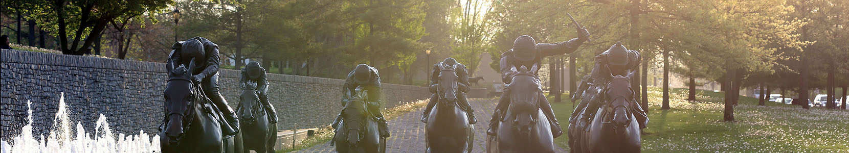 Image of Thoroughbred Park with race horse statues charging towards the viewer.